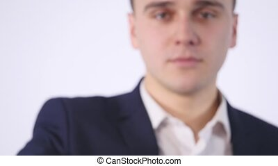 smart phone with green screen in hand of businessman