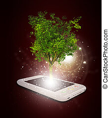 Smart phone with magical green tree and rays of light