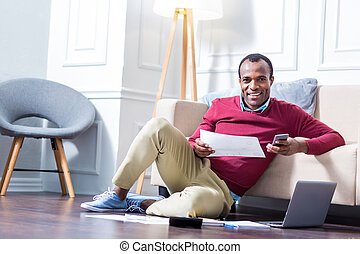 Smart positive man working at home