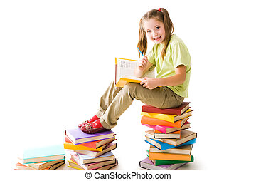 Smart preschooler - Portrait of cute schoolgirl sitting on...