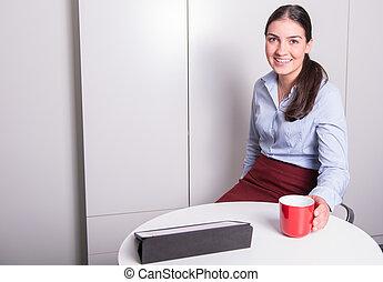 smart professonal woman is having a coffee break in the office