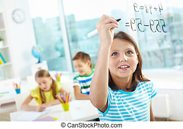 Smart pupil - Portrait of lovely girl doing sums on...