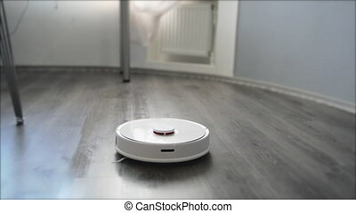 Smart robot vacuum cleaner makes wet cleaning of the...