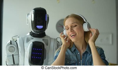 Smart robotic machine dancing while girl singing - This...
