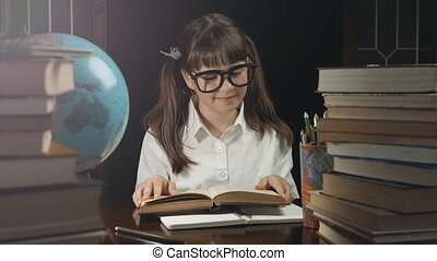 Smart Schoolgirl Studying Process - Portrait of eight years...