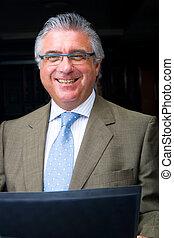 smart senior businessman - a smiling businessman in a suit...