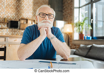Smart senior man working at home