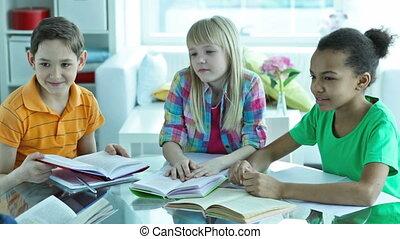 Smart students - Cute schoolchildren answering their...