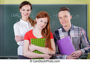 Smart students on chemistry lesson