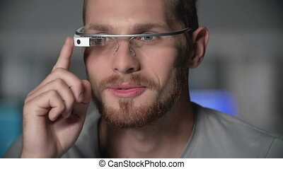 Smart Technology - Man using smart eyewear computer on his...