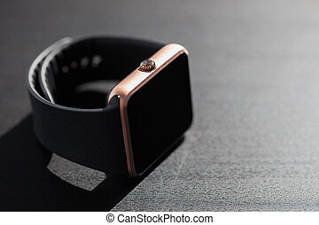 Smart watch lying on table with copy space