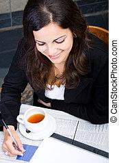 smart woman having tea