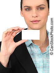 Smart woman holding a blank business card