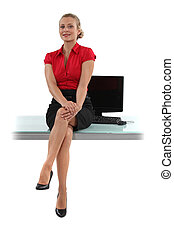 Smart woman sitting on her desk