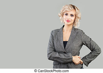 Smart woman smiling on white background. Business woman in suit portrait