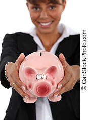 Smart woman with a piggybank