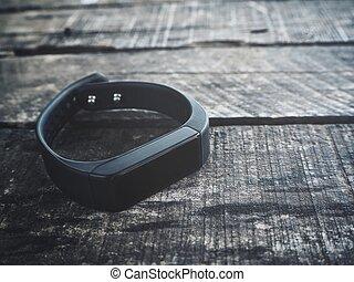 Smart wristband on wood background
