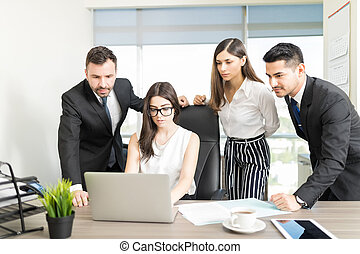 Smart Young Manager Working With Her Team