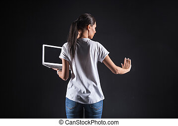 Smart young woman looking at the screen