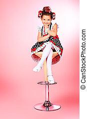 smarten up - Portrait of a cute little pin-up girl over pink...