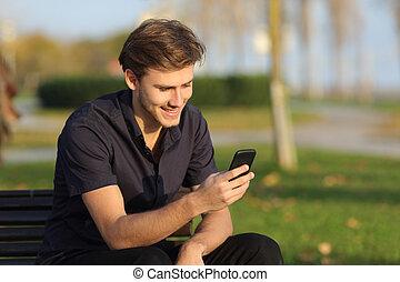 smartphone, モデル, 公園のベンチ, 使うこと, 人