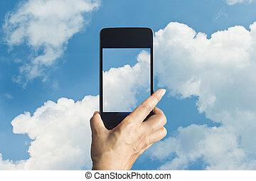 smartphone, 拿, 相片, ......的, 雲, 上, 天空, 背景