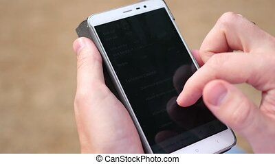 smartphone and hand control close-up