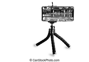 Smartphone and smartphone tripod on white background.