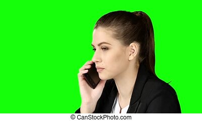 Smartphone businesswoman talking on phone. Green screen