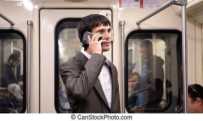 smartphone, conversation, homme affaires, métro