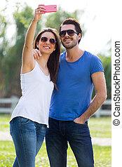 smartphone, ella, toma, parque, joven, selfies, pareja, ...