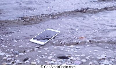 Smartphone falls in the sea water