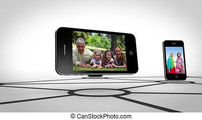 smartphone, famille, ensemble, heureux