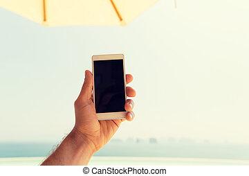 smartphone, feláll, kezezés kitart, becsuk, hím, tengerpart