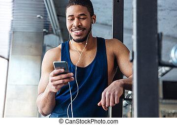 smartphone, ginásio, smilling, condicão física, usando,...