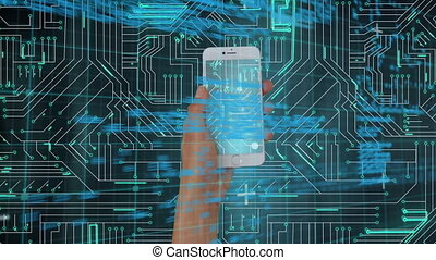Smartphone held by a hand and digital circuit