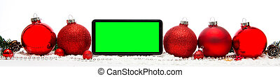 Smartphone in a Christmas white background with christmas balls, gifts and decoration