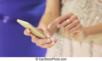 Smartphone in hand woman - Woman holding smart phone and...