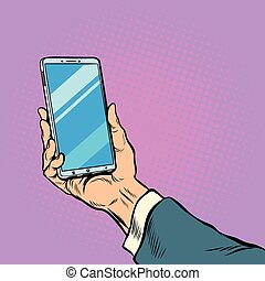 Smartphone in male hand selfie