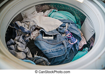 Smartphone in washing machine, Forgotten cell phone in pocket, pant or shirt