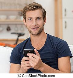 smartphone, młody, dzierżawa, człowiek