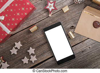 Smartphone on a wooden Christmas table. - Smartphone on a...