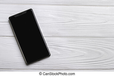 Smartphone on wooden table