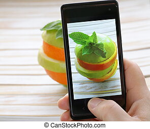 smartphone shot food photo - slices green apple and orange