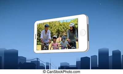 Smartphone showing a family riding