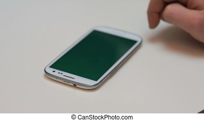 Smartphone sideway zoom - Businessmen zooming on smartphone...