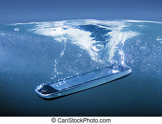 smartphone thrown into water - modern smartphone closeup...
