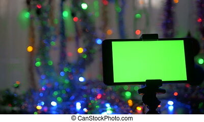 smartphone with a green screen on a new years background movement of the camera