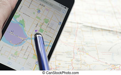 Smartphone with GPS navigator on map - Finding destination...