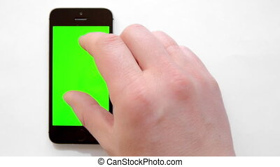 smartphone with green screen, hand clicks